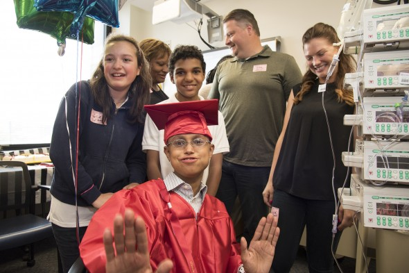 CHUI patient Isaiah Wright graduates from the 8th grade