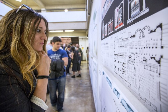 woman looks at architecture plans