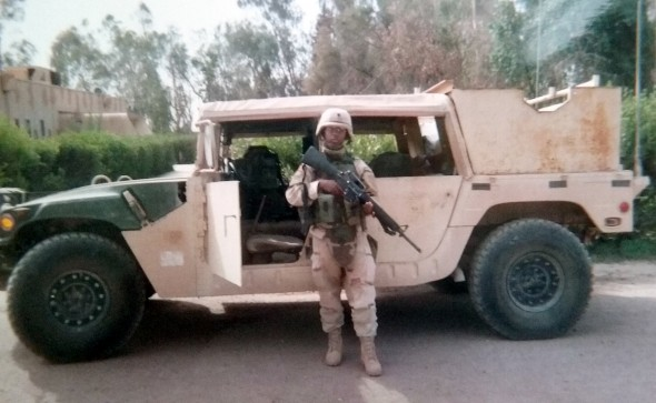 Maria Mckiever in front of a Humvee