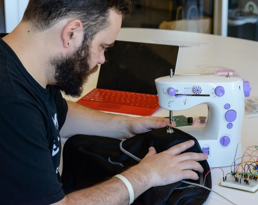 Viktor Mateevitsi sewing his spider sense suit