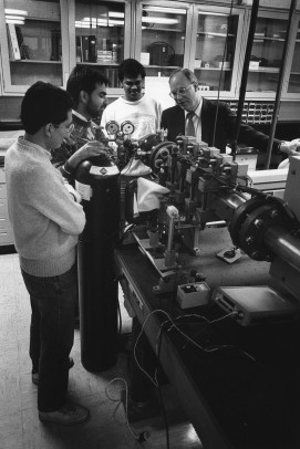 John Kiefer working with students in a lab