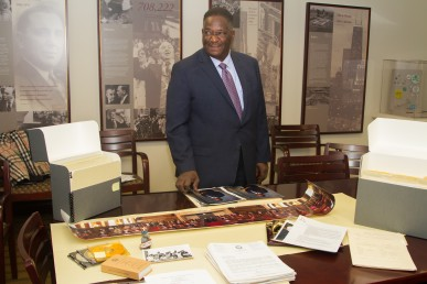 Former Illinois Senate President Emil Jones, Jr. with some of the papers he is donating to UIC.