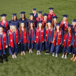 UIC athletes wearing graduation caps and gowns