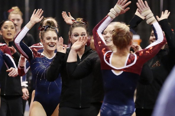 women's gymnastics team celebrating