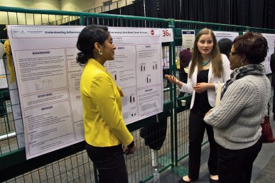 two students presenting their poster