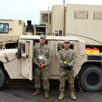 US Army Reserve members outside their Humvee