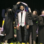 graduate recieves his hood