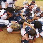 Softball team celebrating their league championship win