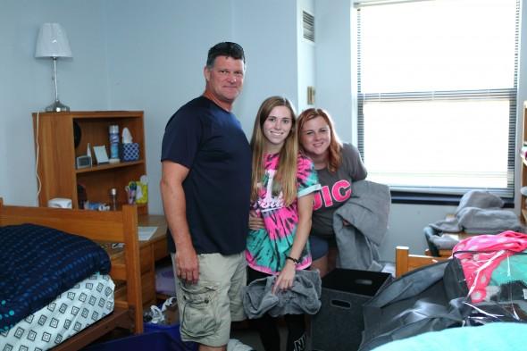 Freshman Rachel MacDowell settled into her residence hall with help from her parents. Photo: Jenny Fontaine
