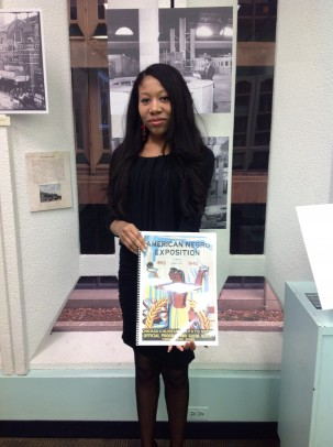 Jacqueline Y. Smith holding a book on the American Negro Exposition