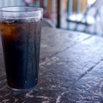 glass of cola on a table