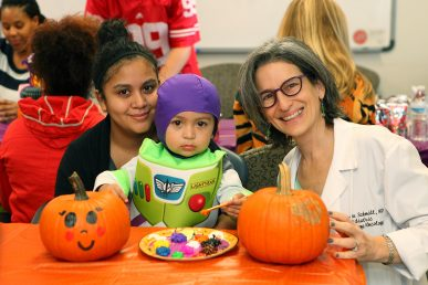 Dr. Mary Lou Schmidt decorates pumpkins with her patient