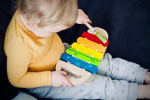 child with xylophone toy