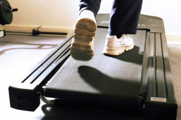 feet of person walking on a treadmill
