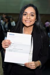 woman holding up her match letter