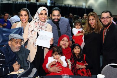woman with her match letter and her family