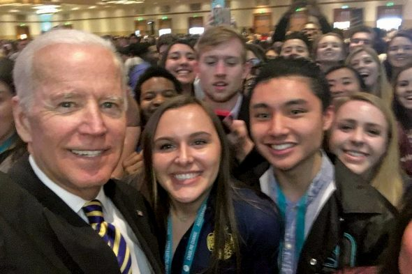 Joe Biden in student selfie with UIC student and ThLB brother Troy Tolentino in front row
