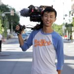 "Bing Liu holding film camera on ""Minding the Gap"" set."