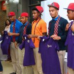 Butler College Prep students and purple polo shirts.