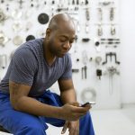 Man texting in workshop