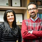 Professor Hossein Ataei and student Michelle Calcagno standing together in Hossein's office.