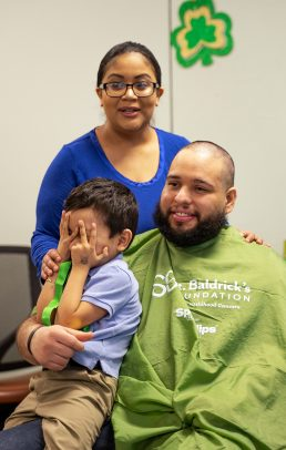 Cancer survivor Isaac Felix with his parents, Raphael and Diana.