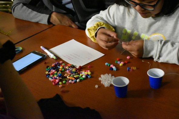"""Crafting binary-code bracelets during the """"Mom, Me and SWE"""" event."""