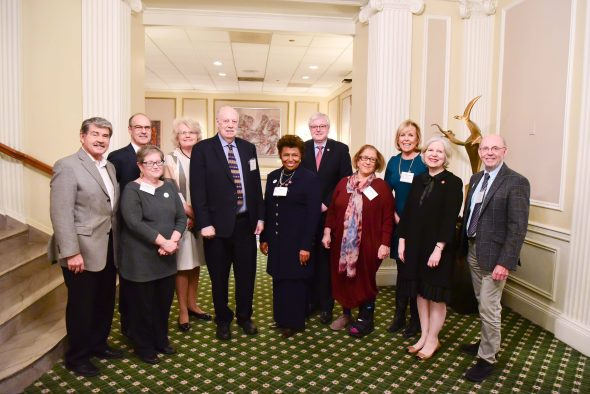 Dick Simpson, professor of political science and honoree, with steering committee members