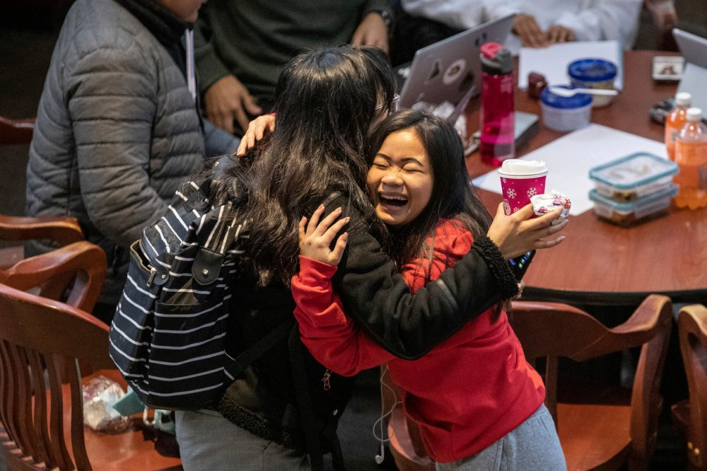Karen Cumba (LAS '23), right, greets her friend Ria Bonjoc (LAS '23) in the atrium of SRCN after returning from winter break on the first day of spring semester Monday, Jan. 13, 2020.