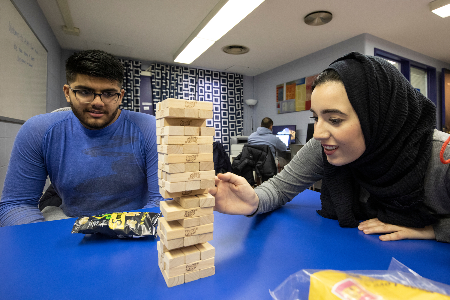 Tamara Jumah (LAS '22), right, plays Jenga with Zakee Jabbar (LAS '20) during AHS Academic Support and Achievement Program's open house in the Physical Education Building.