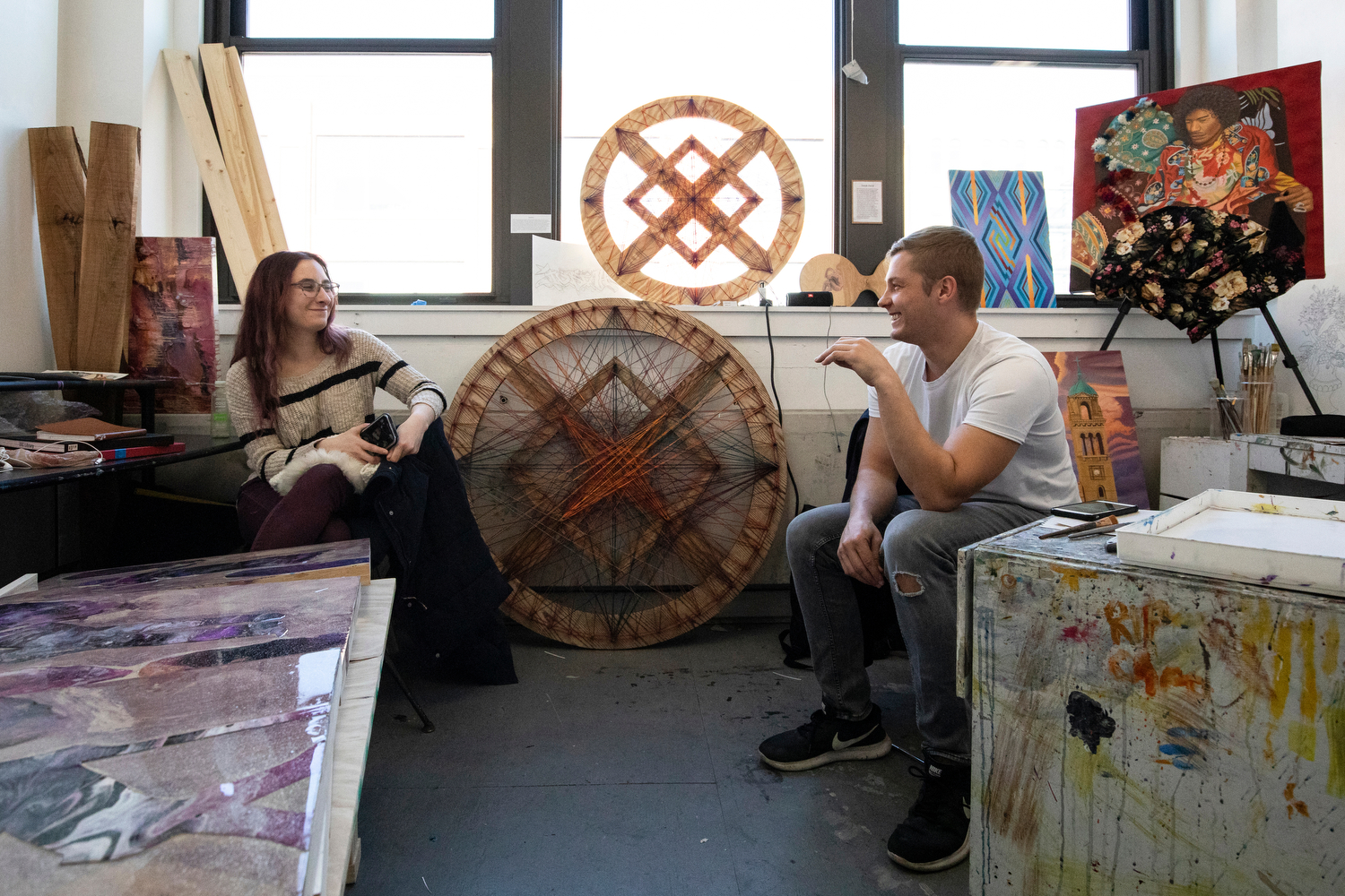 Alicia Meyer (CADA '20) and Josiah David (CADA '20) chat in the BFA thesis studio in Art and Design Hall as they wait for one-on-one studio visits from professors during their thesis course.
