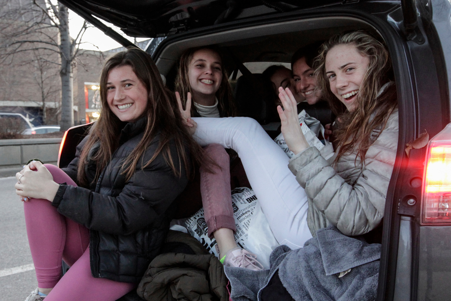 Students pack the back of an SUV after class on Roosevelt Road near the Flames Athletic Center.