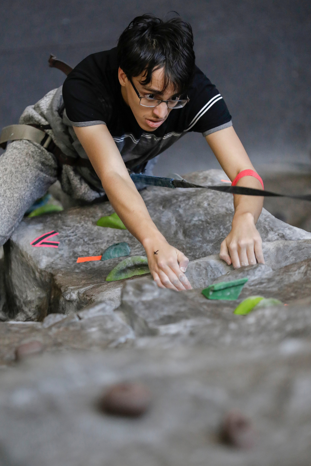 A student tries out rock climbing during the Campus Recreation open house at the Student Recreation Facility. Each semester, an open house is held for faculty, staff and students to see what Campus Recreation has to offer.