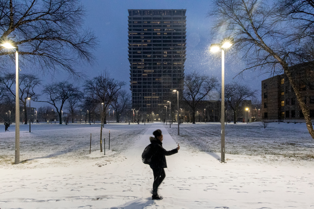 Students leave campus on Friday as a snow storm descends over east campus.