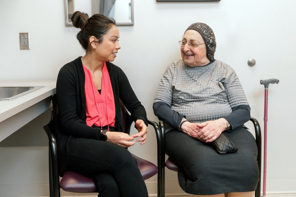 Former UIC occupational therapy student talks with a patient in the Self-management service of the Occupational Therapy Faculty Practice