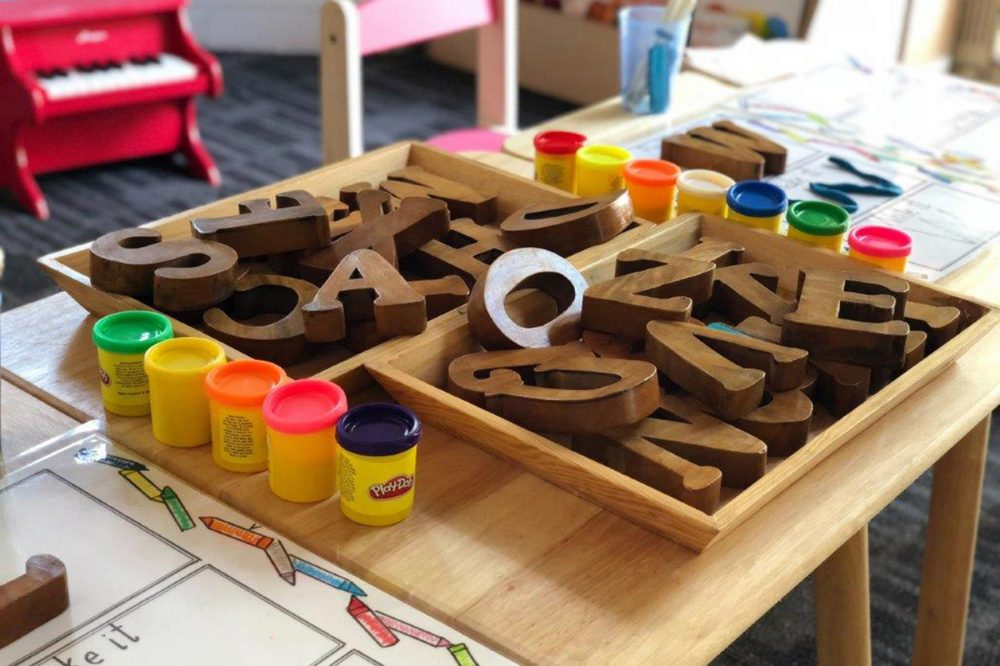 Play-Doh and wooden letters.