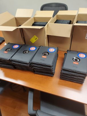 iPads donated to UI Health by Cubs Charities sit in boxes.