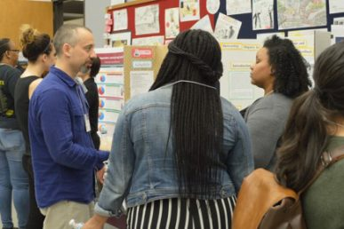 UIC College of Education Assistant Professor of Science Education Daniel Morales-Doyle speaks with public school teachers and alumna at a UIC gathering focusing on urban science education initiatives.