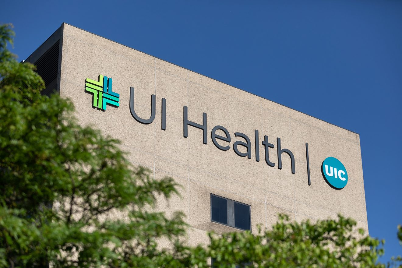 The east side of the University of Illinois Hospital displays the UI Health and UIC logo.
