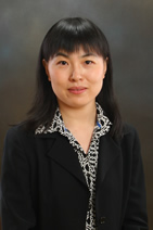 Ning Ai, headshot on gray background
