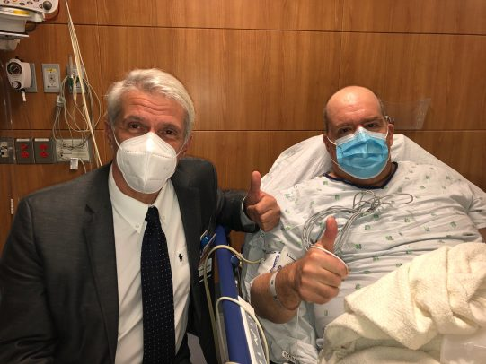 Dr. Pier Giulianotti sits with a UI Health transplant patient