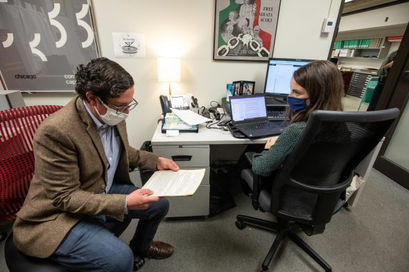 University archivist Leanna Barcelona and lecturer David Greenstein work in the archives at the University Library. (Joshua Clark/University of Illinois Chicago)