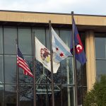 American flag, Illinois state flag, Chicago flag, and UIC flag flying outside Student Center East