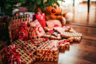 Collection of Christmas presents under the tree.