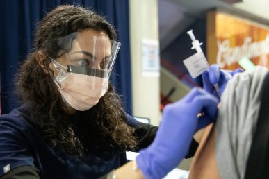 Dentistry student Inesa Tshagharyan administers COVID-19 vaccinations at the Credit Union 1 Arena on Monday, Feb. 1, 2021, at the University of Illinois Chicago. (Joshua Clark/University of Illinois Chicago)