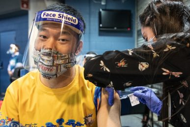 CPS teacher Xiaomin Fei receives the first shot of COVID-19 vaccine at the Credit Union 1 Arena on Monday, Feb. 1, 2021, at the University of Illinois Chicago. (Joshua Clark/University of Illinois Chicago)