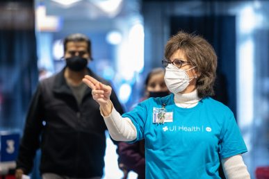Dentistry Associate Dean Dr. Susan Rowan directs people to vaccinators at Credit Union 1 Arena on Monday, Feb. 1, 2021, at the University of Illinois Chicago. (Joshua Clark/University of Illinois Chicago)