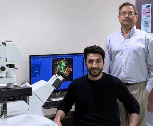Alex Agelid and Dr. Deepak Shukla in their research lab.