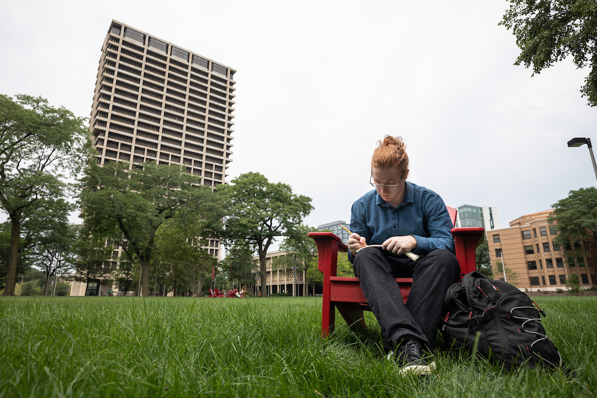 A student studies on the lawn outside ADS on Tuesday, July 27, 2021.
