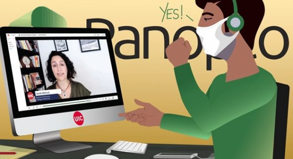 A person wearing a mask sits in front of a computer with a person on the screen